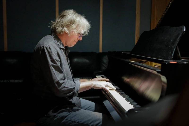 R.E.M. bassist Mike Mills plays piano.