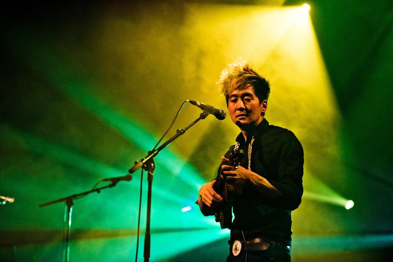 Kishi Bashi performs on stage.