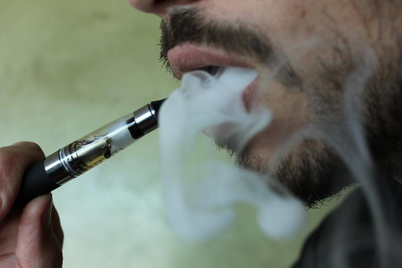 A man 'vaping' from an electronic cigarette. (photo courtesy of Lindsay Fox at http://ecigarettereviewed.com)