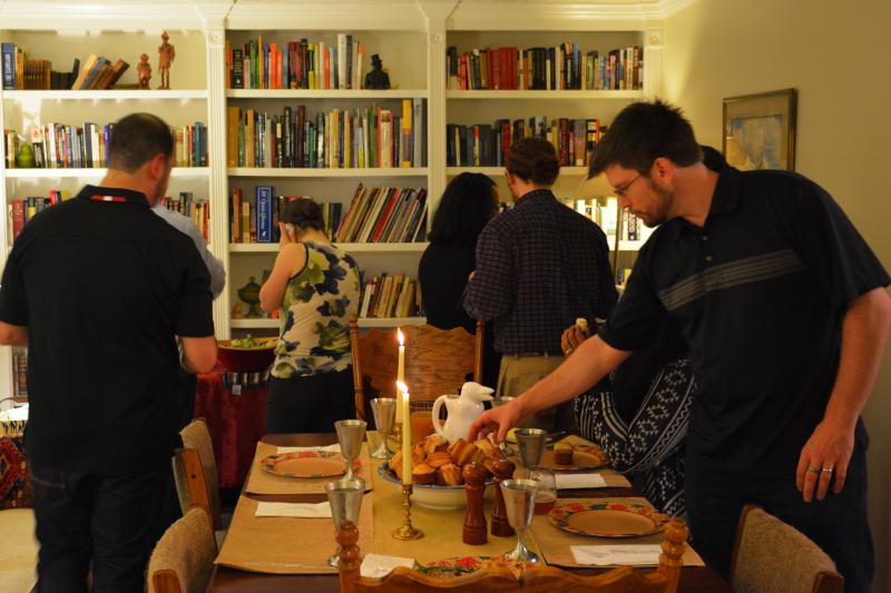 Guests gathering around the Friendsgiving buffet at the Bradfords' home in Roswell.