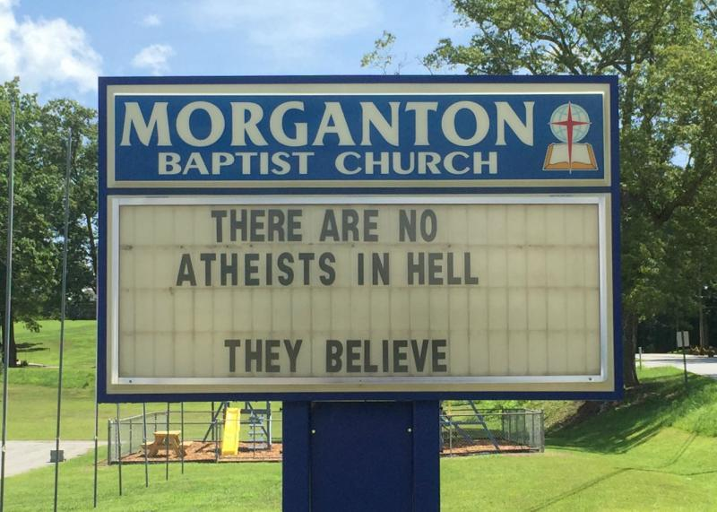 """A sign in front of the Morganton Baptist Church reads, """"There are no atheists in hell. They believe."""""""