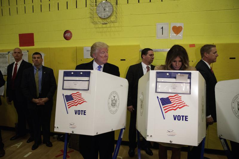 Republican presidential candidate Donald Trump looks at his wife Melania as they cast their votes at PS-59, Tuesday, Nov. 8, 2016, in New York.