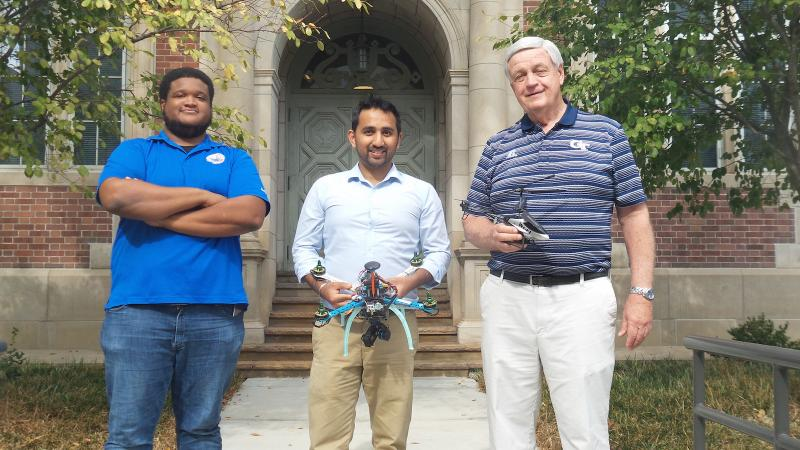 GA Tech graduate students (L to R) Kreston Barron, Srujal Patel, and Dr. Daniel Schrage at the Daniel F. Guggenheim Building for Aerospace Engineering on the GA Tech campus.