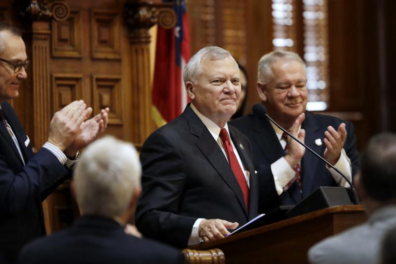 In this file photo from Jan. 11, 2017, Georgia Gov. Nathan Deal steps to the podium to deliver the State of the State address on the House floor while applauded by Lt. Gov. Casey Cagle, left, and House Speaker David Ralston, right, in Atlanta.