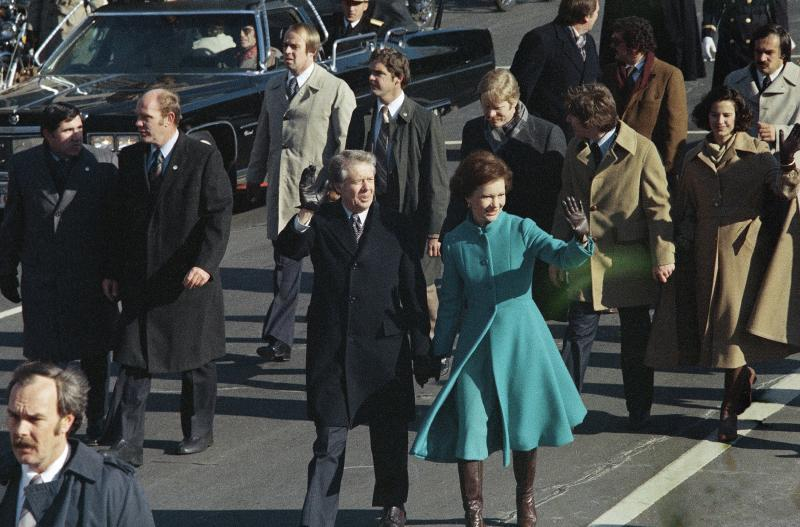 This Jan. 20, 1977 photo shows President Jimmy Carter and First Lady Rosalynn Carter waving as they walk down Pennsylvania Avenue in Washington after Carter was sworn in as the nation's 39th president.