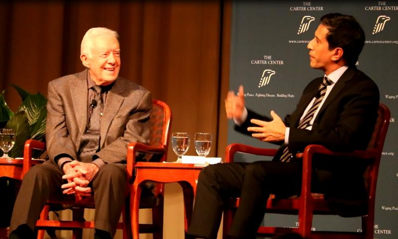 Former U.S. President Jimmy Carter and CNN Chief Medical Correspondent Dr. Sanjay Gupta speaking to an audience at the Carter Center in Atlanta, Wednesday January 11, 2017.