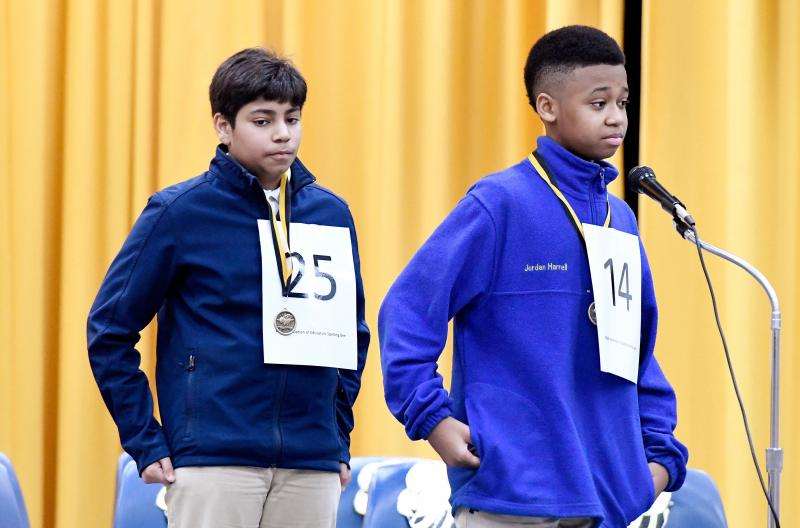 Bibb County Schools Spelling Champion Jordan Harrell, right, during the 2017 district spelling bee.