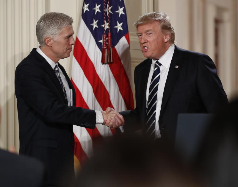 Judge Neil Gorsuch shakes hands with President Donald Trump as he is announced as Trump's choice for Supreme Court Justice during a televised address from the East Room of the White House in Washington, Tuesday, Jan. 31, 2017.
