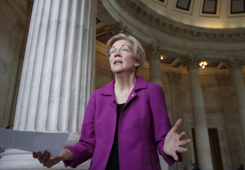 Holding a transcript of her speech in the Senate Chamber, Democratic Sen. Elizabeth Warren of Massachusetts reacts to being rebuked by the Senate leadership and accused of impugning a fellow senator, Wednesday, Feb. 8, 2017.