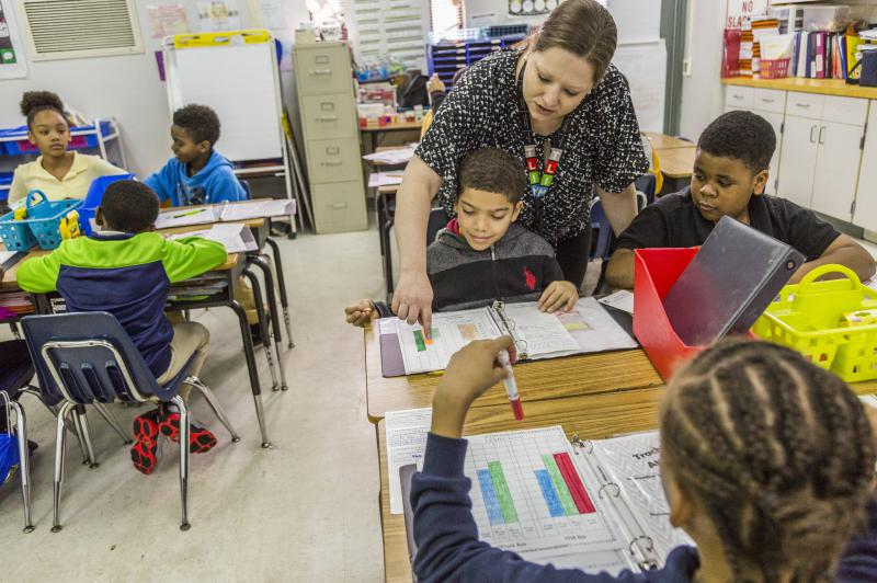 Alison Scott goes over reading data with students in her second grade class at Burdell Elementary in Macon.
