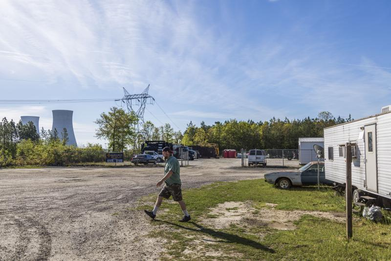 Jonathan Fensamaker walks from his RV to the convenience store where he works across from Plant Vogtle near Waynesboro, Ga. Fensamaker shares his RV park with many of the temporary construction workers at the plant.
