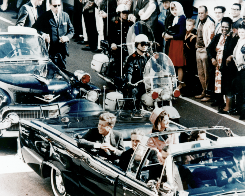 President John F. Kennedy minutes before the assassination. A popular conspiracy theory is that there were multiple shooters.