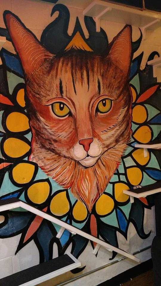 A large cat painting at Java Cats Café in Atlanta.