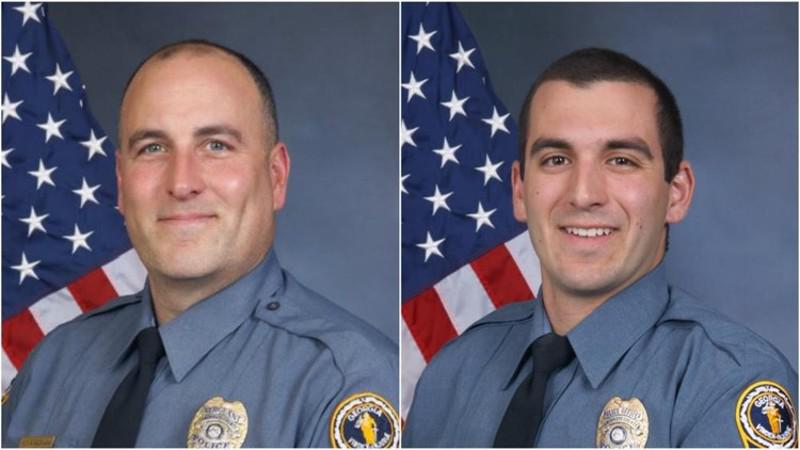 Former Gwinnett County Police Department officers Michael Bongiovanni (left) and Robert McDonald face felony and misdemeanor charges for punching and kicking a man during a traffic stop.