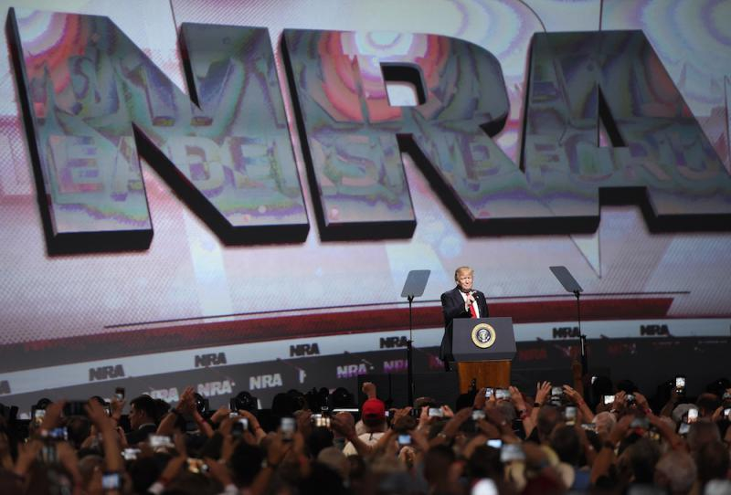 President Donald Trump speaks at the National Rifle Association-ILA Leadership Forum, Friday, April 28, 2017, in Atlanta. The NRA is holding its 146th annual meetings and exhibits forum at the Georgia World Congress Center.