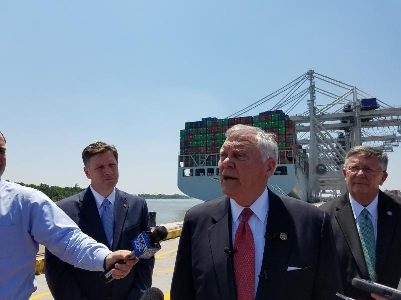 In this file photo from May 12, 2017, Gov. Nathan Deal speaks to reporters at the Port of Savannah, in front of the largest container ship ever to call on the East Coast.