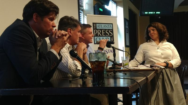 As part of an Atlanta Press Club panel discussion, On Second Thought host Celeste Headlee talked with (l to r) Richard Fausset of The New York Times, Cam McWhirter of The Wall Street Journal, and Martin Savidge of CNN.