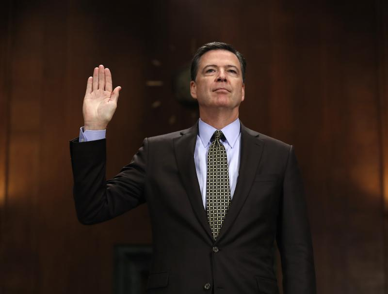 "FBI Director James Comey is sworn-in on Capitol Hill in Washington, Wednesday, May 3, 2017, prior to testifying before the Senate Judiciary Committee hearing: ""Oversight of the Federal Bureau of Investigation."""