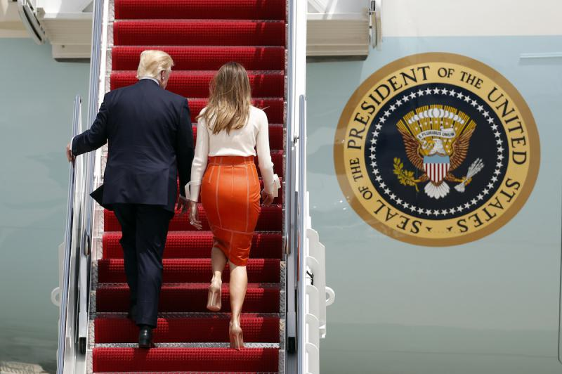President Donald Trump, with first lady Melania Trump, board Air Force One at Andrews Air Force Base, Md., Friday, May 19, 2017, prior to his departure on his first overseas trip.