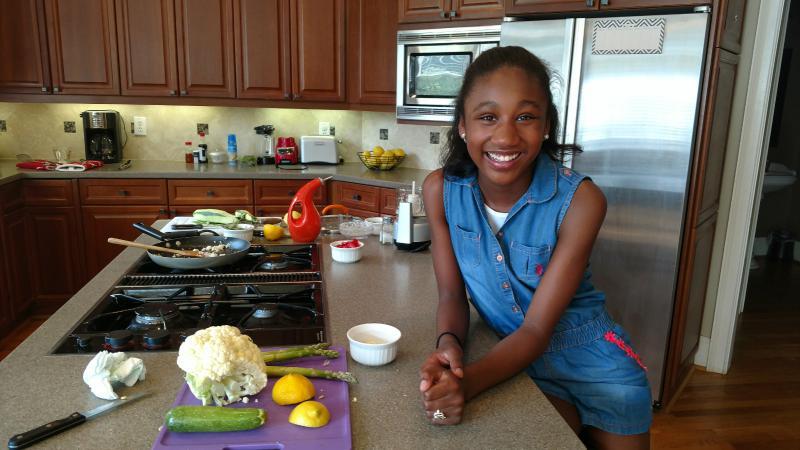 Jasmine Stewart of Milton, Georgia in her kitchen.