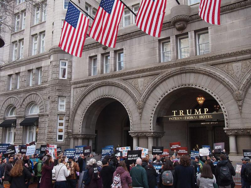 "Participants in a ""No Muslim Registry"" march outside the Trump International Hotel located in the Old Post Office in Washington, D.C. in December 2016."