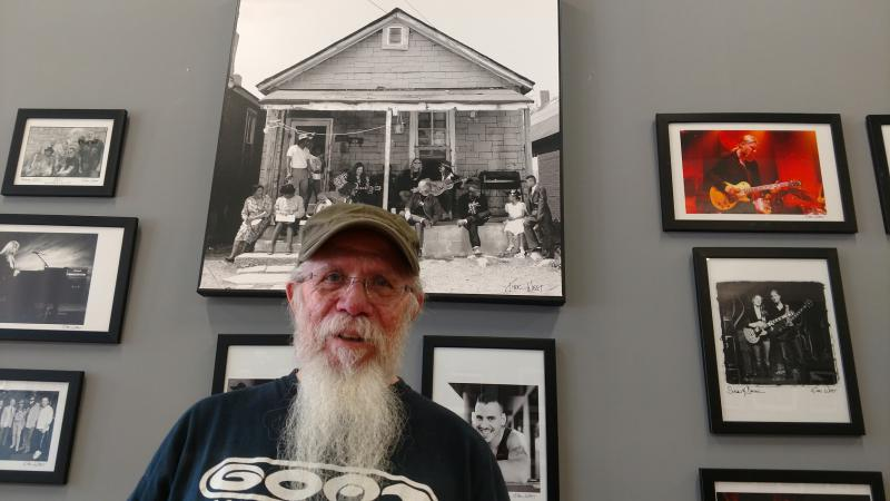 Kirk West, former Allman Brothers Band tour manager, stands in front of photographs he took of the group. West's documentary looks at the band's time at The Big House in Macon.