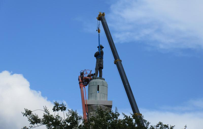 In this May 19, 2017 photo, workers prepare to take down the statue of former Confederate general Robert E. Lee in New Orleans.