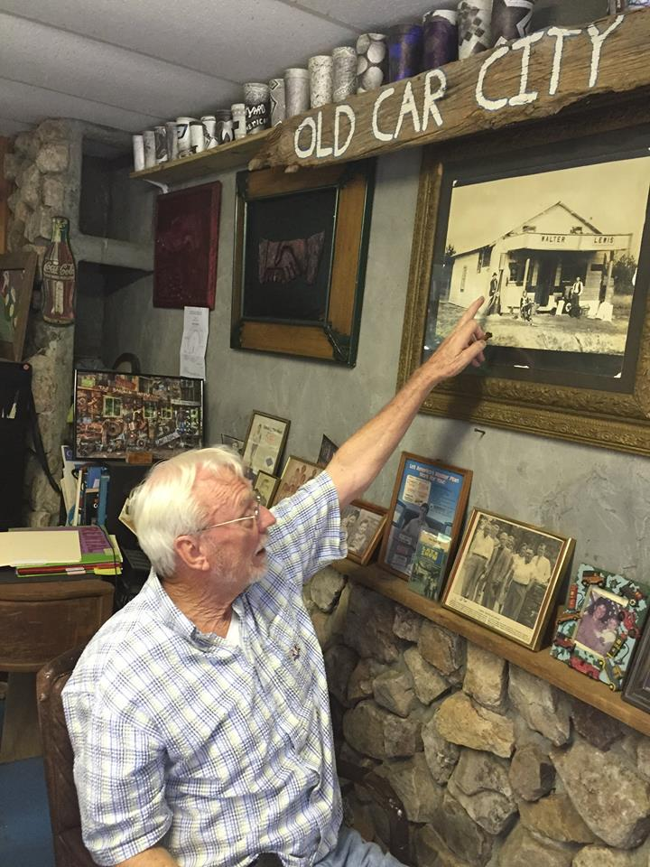 Dean Lewis is the owner of Old Car City USA. Old Car City started as a Car Dealership in 1931 under his parent's leadership. Lewis points to a picture of his parents.