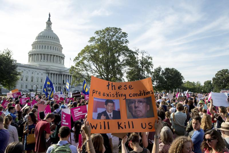 People rally against the Senate Republican health care bill on the East Front of the Capitol in Washington, Wednesday, June 28, 2017.
