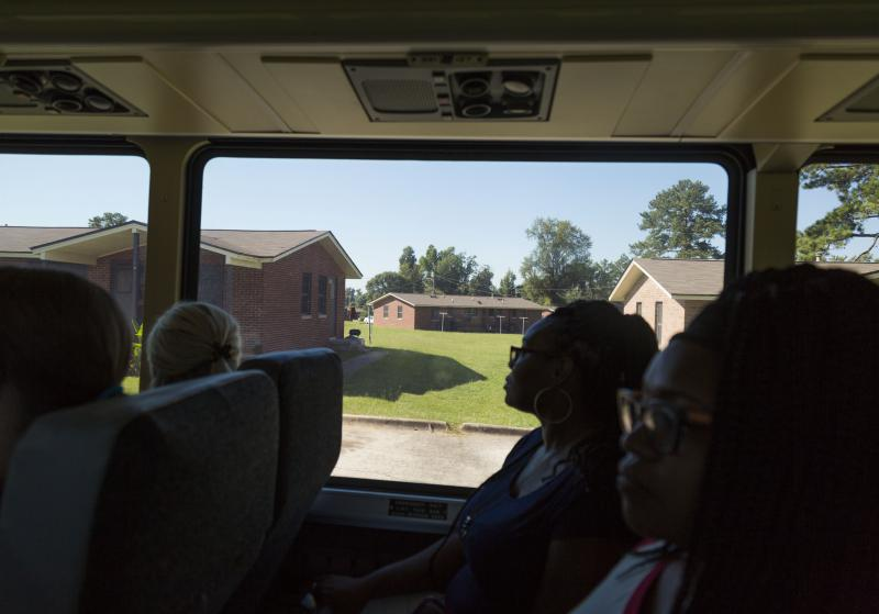 Teachers ride a tour bus through the public housing project known as Bird City in Macon while on a tour of the Hartley Elementary School district.