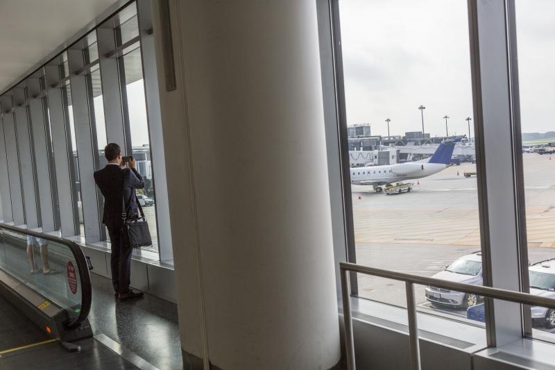 Contour Airlines CEO Matt Chaifetz takes a photo of his company's jet at the terminal at the airport in Baltimore.