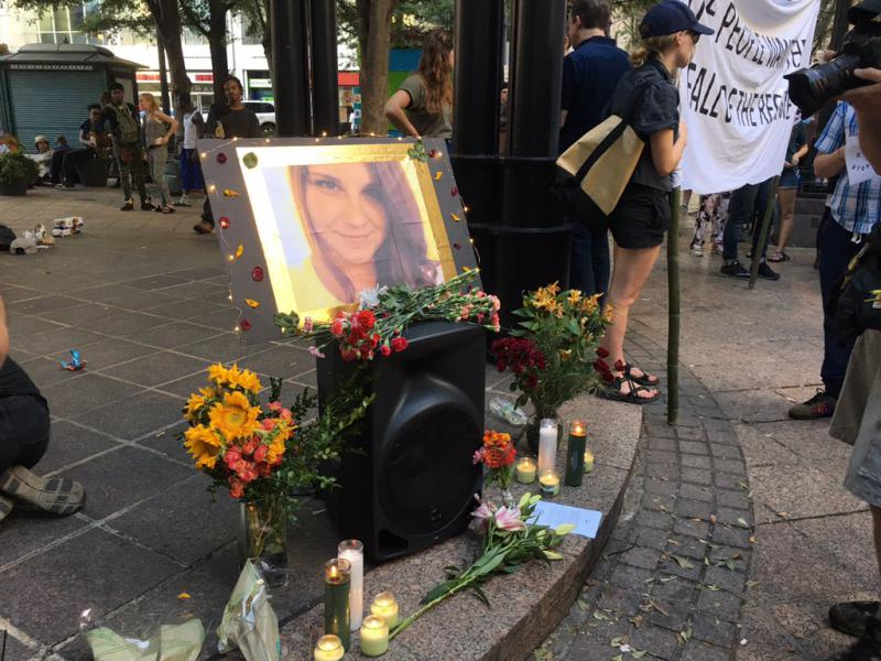 Demonstrators in Atlanta's Woodruff Park set up a memorial to Heather Heyer, who was killed when a car rammed a group of protesters in Charlottesville, Va.
