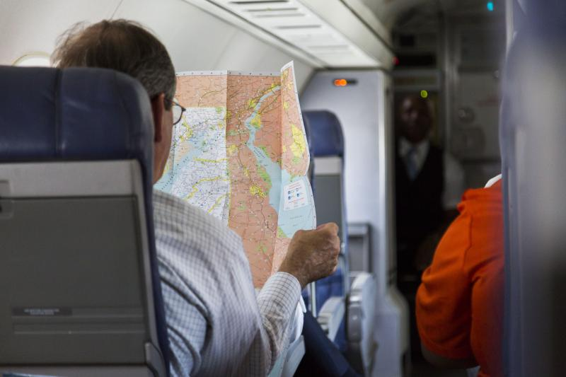 Macon Mayor Robert Reichert looks at a map of the Washington DC area onboard the inaugural flight from Macon to Washington, D.C., aboard Contour Airlines.