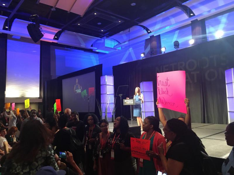 "GA gubernatorial candidate Stacey Evans struggles to deliver a speech as protestors chant ""Trust Black Women"""