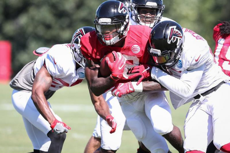 Members of the Atlanta Falcons practice at the team's training camp.