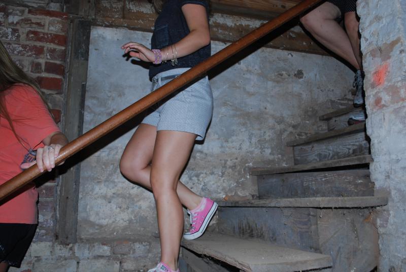 Tour-goers explore Rome underground.