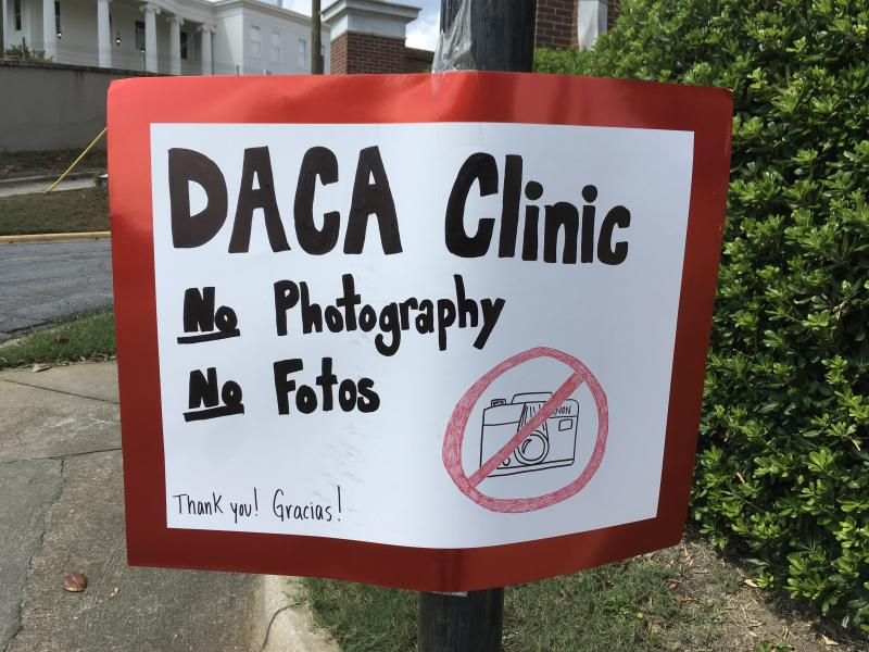 Handmade sign for DACA Renewal Clinic at Mercer University's School of Law.