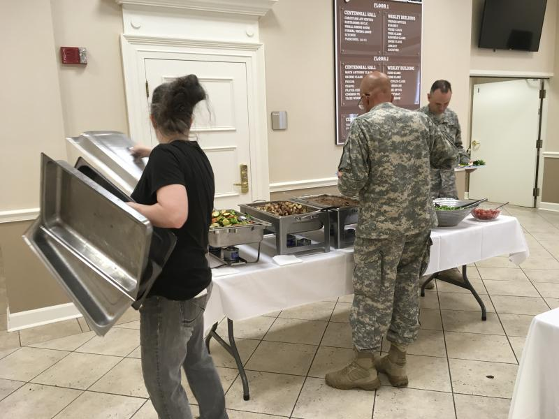 Saralyn Collins with Grow Restaurant serves lunch to members of the Georgia Department of Defense's 5th Brigade at Vineville Methodist Church.