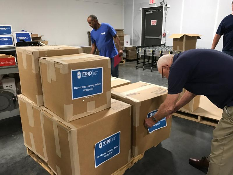 Disaster health kits are prepared for victims of Hurricane Harvey.