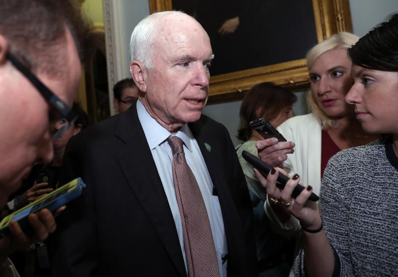 Sen. John McCain, R-Ariz., speaks with reporters before heading into a policy luncheon on Capitol Hill, Tuesday, Sept. 19, 2017, in Washington.