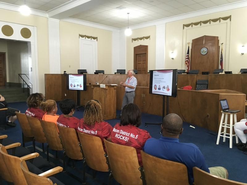 Red Cross trainer Gaines Harman trains volunteers in Macon Government Center.