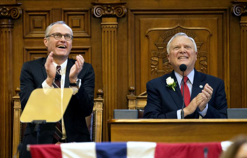 Georgia Gov. Nathan Deal, right, looks up along with Lt. Gov. Casey Cagle, left, while speaking during an inaugural ceremony to begin his second term in office at the state Capitol.