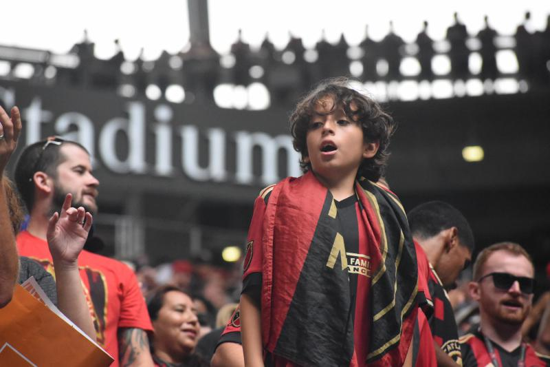 A young ATL United fan takes in the action at Mercedes Benz Stadium.