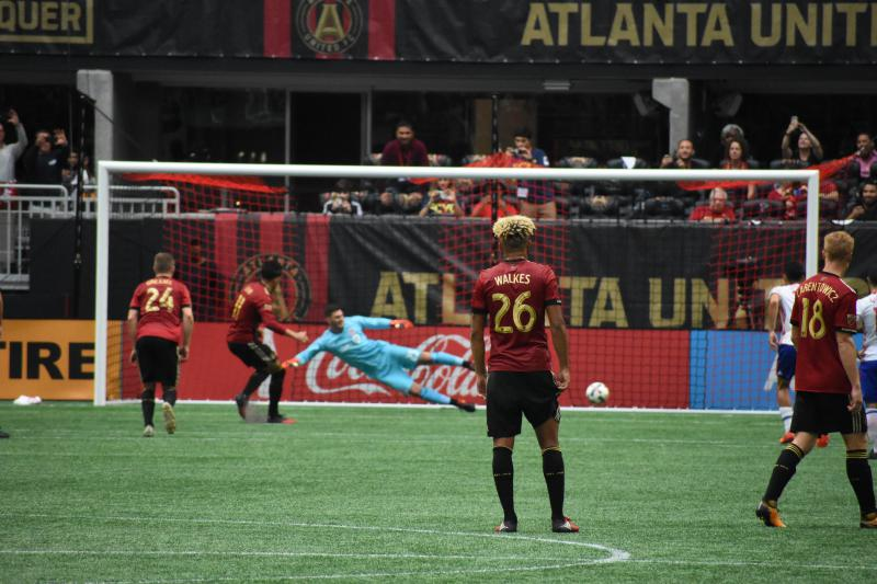 Yamil Asad (11) scores on a penalty kick against Toronto FC as Anton Walkes (26) looks on.