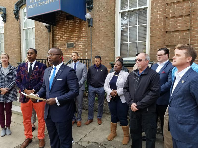 Antwan Lang of the Savannah Jaycees (center), along with leaders of National Action Network, the Young Democrats and Republicans and other groups, calls for the Savannah-Chatham Metropolitan Police Department to remain merged.