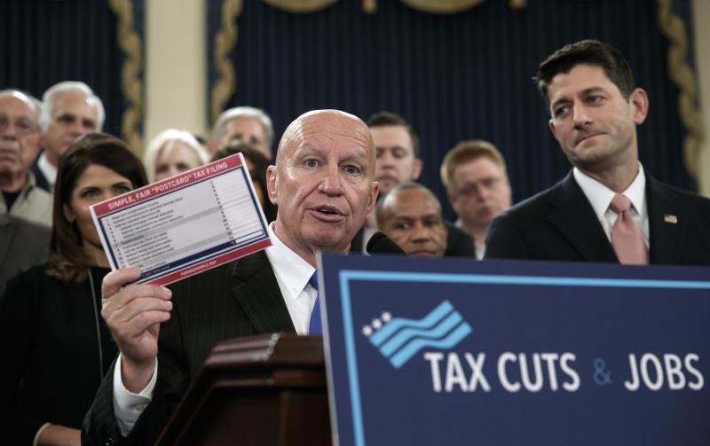 House Ways and Means Committee Chairman Kevin Brady, R-Texas, joined by Speaker of the House Paul Ryan, R-Wis., right, as they unveil the GOP's far-reaching tax overhaul, on Capitol Hill in Washington, Thursday, Nov. 2, 2017.