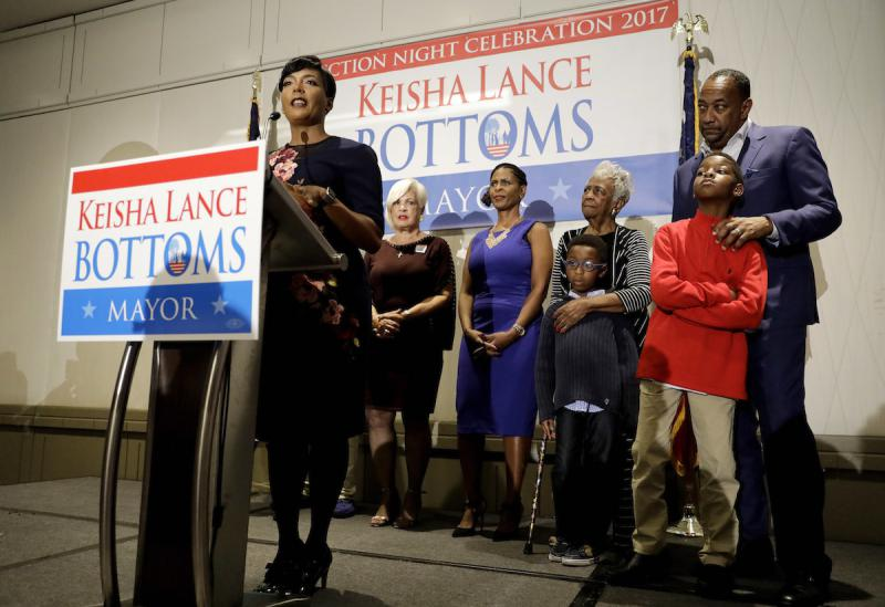 Atlanta city councilwoman and mayoral candidate Keisha Lance Bottoms speaks at an election night party surrounded by family in Atlanta, early Wednesday, Nov. 8, 2017.