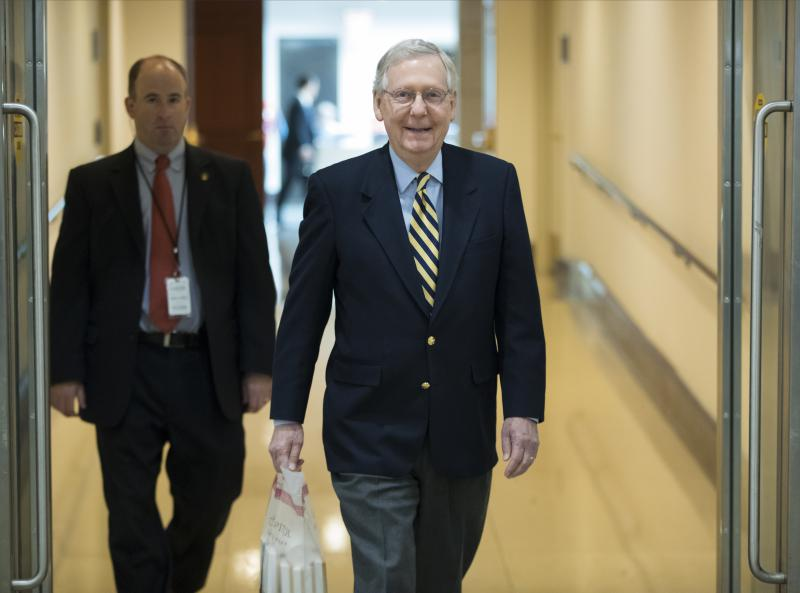 Senate Majority Leader Mitch McConnell, R-Ky., walks through the Capitol as lawmakers return to work after their Thanksgiving break to face unfinished business on taxes and spending, in Washington, Monday, Nov. 27, 2017.