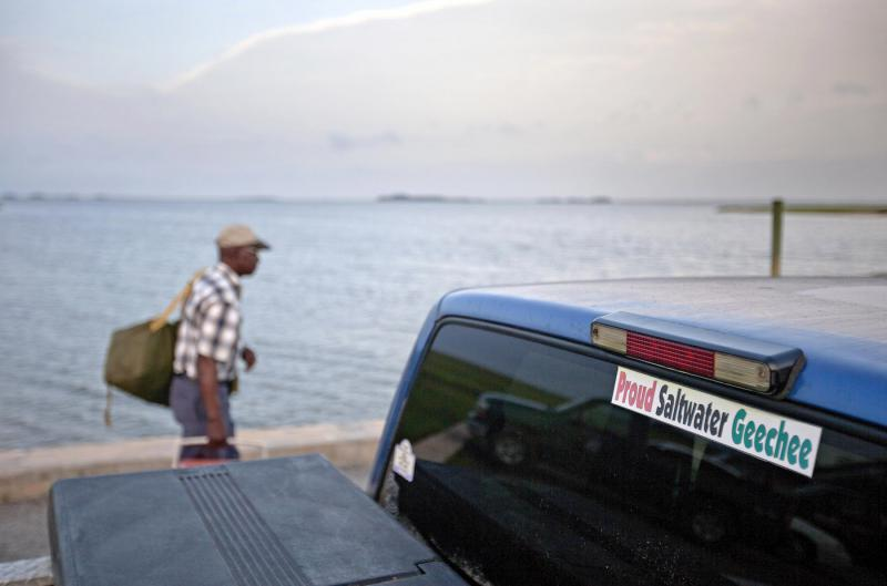 In this June 10, 2013 file photo, a sticker celebrating the Geechee heritage is seen on a pickup truck as passengers board a ferry to the mainland from Sapelo Island, Ga.