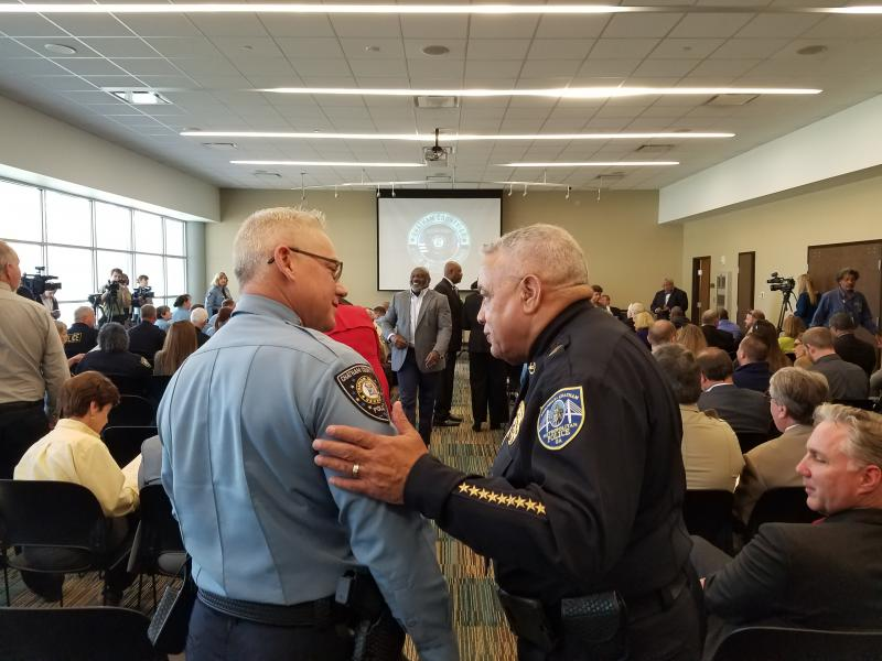 Chatham County Police Chief Jeffrey Hadley (left) greets Savannah-Chatham Police Chief Jack Lumpkin prior to Hadley's swearing in ceremony. The county and city departments will split Feb. 1.
